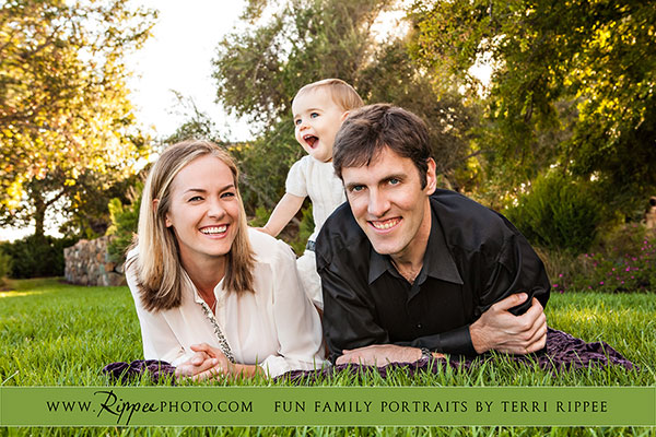Natural kids photography:  Mazey straddling mom and dad