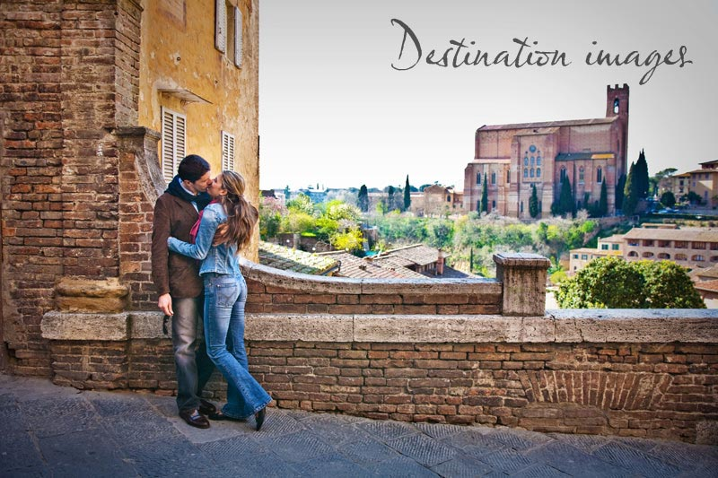 Destination Wedding Photography of Couple Kissing With Scenic Background