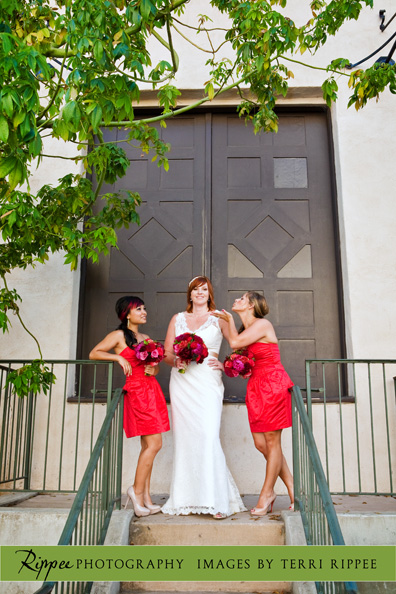 Erin and Erwin's Wedding at the Prado in Balboa Park: Bride standing with Brides Maids on Stairs