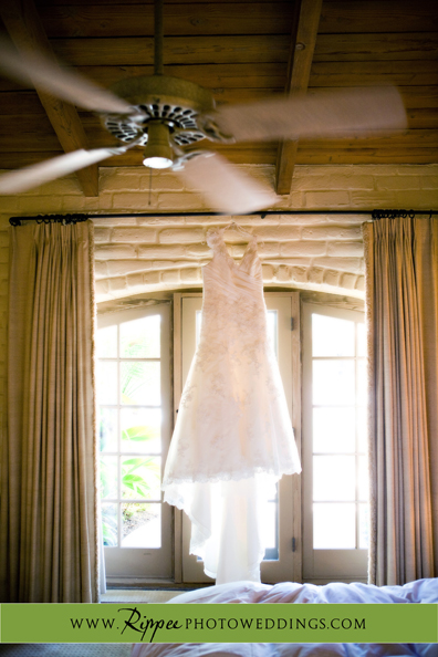 Megan and Steve Rancho Valencia Wedding: Dress Hanging in Front of Window