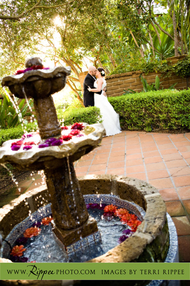 Megan and Steve Rancho Valencia Wedding: Bride and Groom Kissing by the Fountain