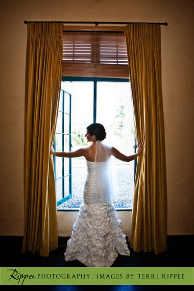 Wedding at the Prado: Bride looking out the window