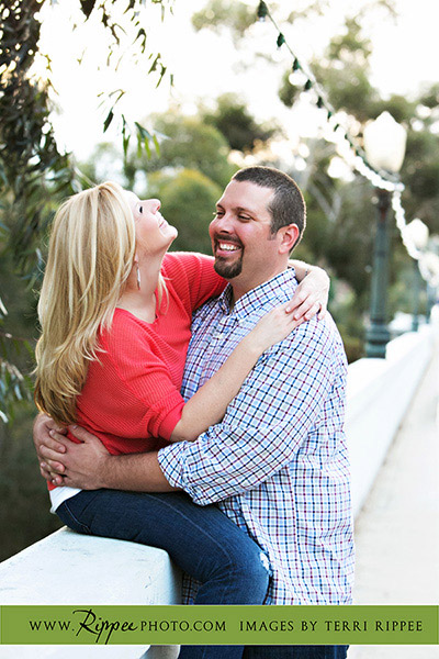 Balboa Park Engagement Photography: Sitting on Bridge Rail