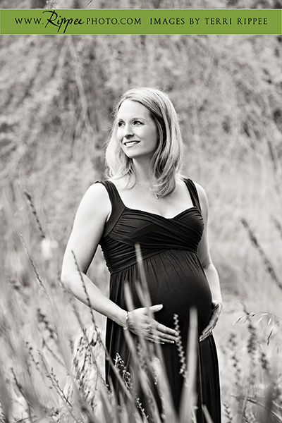 Stephanie's maternity session: Holding Belly in Field