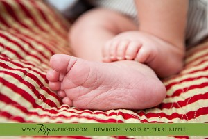 Newborn Baby Dane Joins the Family: Baby Dane's Feet on Red and White Striped Blanket