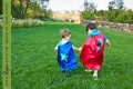 Two boys in superman capes